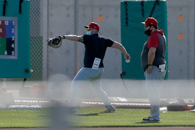 Cincinnati Reds director of pitching Kyle Boddy (right) oversees a session during a midday spring training workout at the Cincinnati Reds Player Development Complex in Goodyear, Ariz., on Saturday, Feb. 27, 2021.