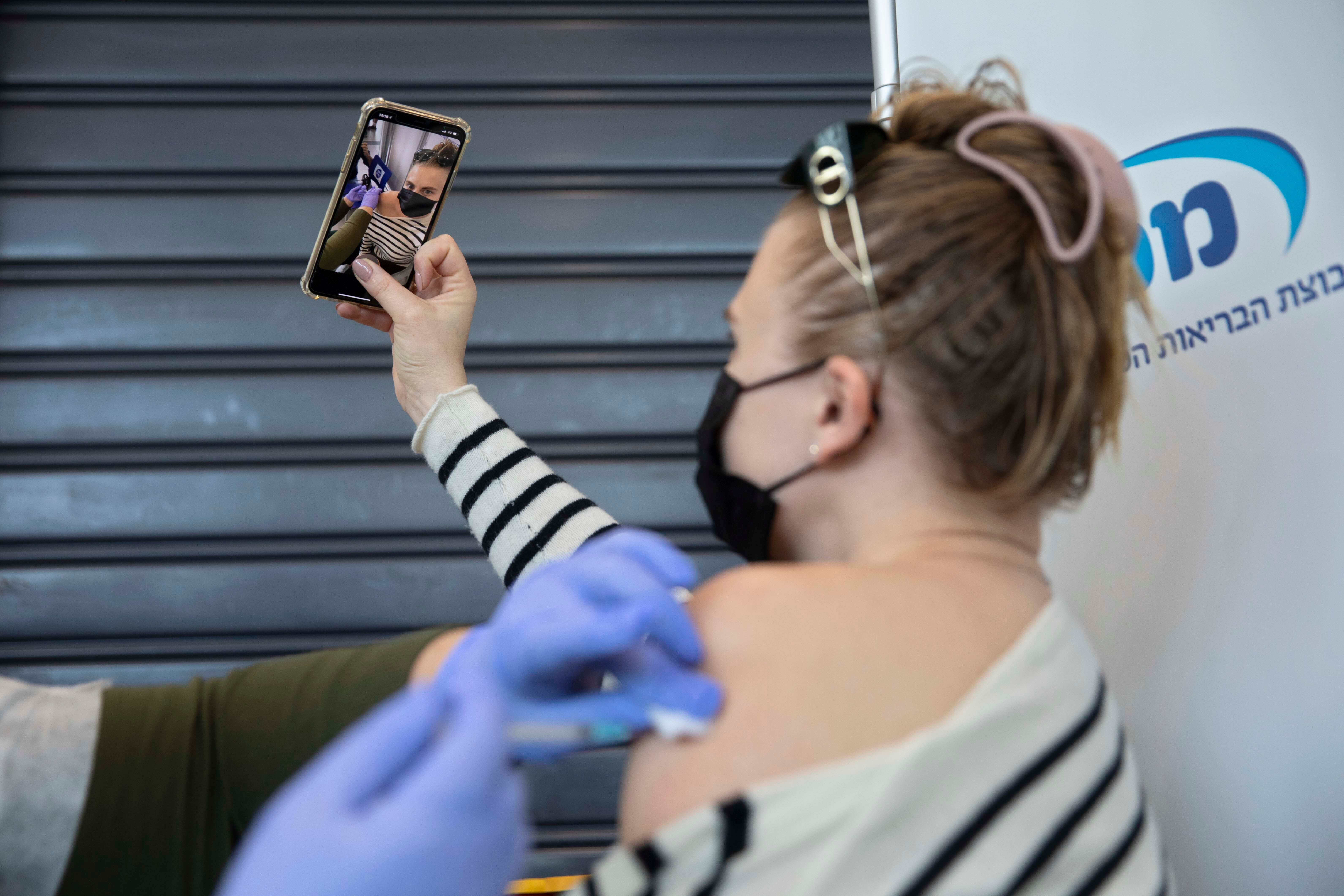 To selfie or not to selfie? Why the joy of getting vaccinated is drawing backlash 2