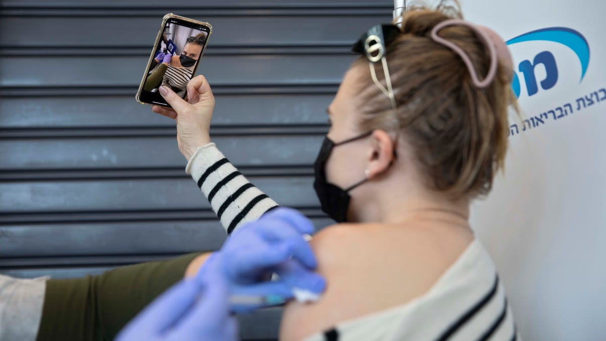 To selfie or not to selfie? Why the joy of getting vaccinated is drawing backlash 3