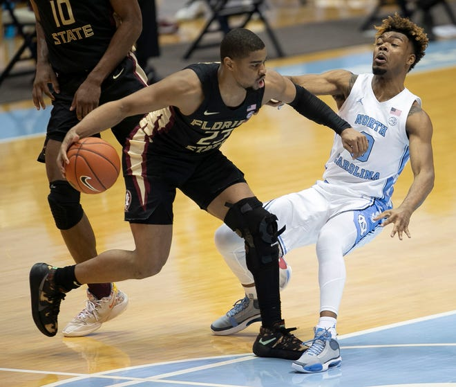 Florida State's M.J. Walker (23) drives against North Carolina's Anthony Harris (0) during the second half on Saturday, February 27, 2021 in Chapel Hill, N.C.