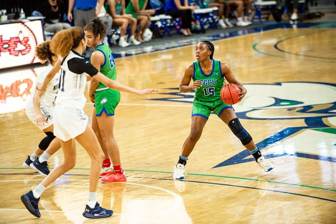 FGCU's Tyra Cox looks to take a shot during a game against North Florida on Sunday, Feb. 28, 2021.