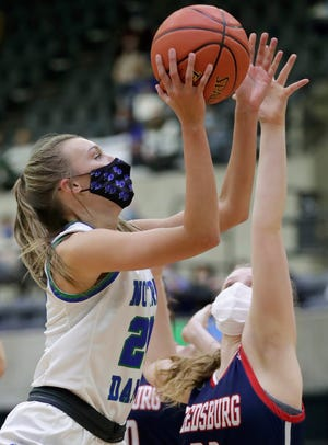 Notre Dame's Sammy Opichka puts up a shot against Reedsburg's Macie Wieman during their Division 2 state championship basketball game Feb. 27 at the La Crosse Center.
