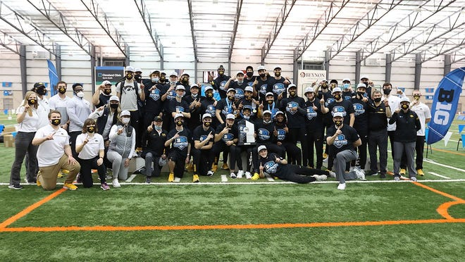 The Iowa men's track and field is shown after scoring a school-record 119 points in winning the Big Ten Indoor Championships on Saturday.