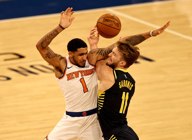 Feb 27, 2021; New York, New York, USA; Domantas Sabonis #11 of the Indiana Pacers tries to take a shot as Obi Toppin #1 of the New York Knicks is called for a foul in the second quarter at Madison Square Garden. Mandatory Credit:  POOL PHOTOS-USA TODAY Sports