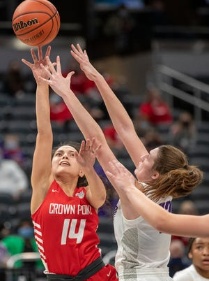 Crown Point High School's Jessica Carrothers (14) is guarded by Brownsburg High School's Ally Becki (22) on Saturday, Feb. 27, 2021, during the girls Class 4A basketball finals from Bankers Life Fieldhouse in Indianapolis. CPHS won 44-34.