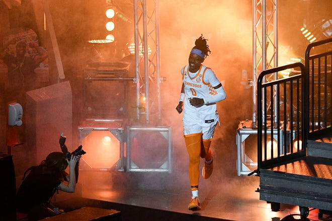 Tennessee's Rennia Davis races onto the floor for pregame introductions in a February women's basketball game against Auburn. Davis, a state champion at Ribault High School, is entering the 2021 WNBA Draft.