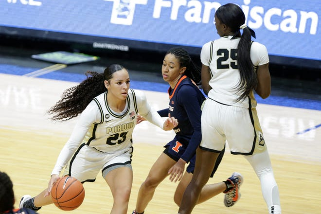 Purdue forward Tamara Farquhar (25) screens Illinois guard Jada Peebles (11) for Purdue guard Kayana Traylor (23) during the second quarter of an NCAA women's basketball game, Sunday, Feb. 28, 2021 at Mackey Arena in West Lafayette.