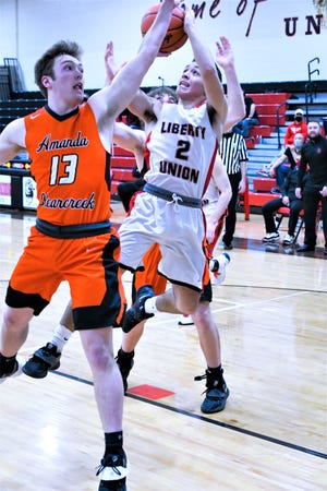 Liberty Union senior guard Ty Boggs goes up for a shot against Amanda-Clearcreek's Brody Pugh during Saturday's Division III sectional final. The Lions won, 51-44.
