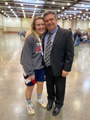 Creek Wood 2021 state wrestling champion Shelby Zacharias with coach Jimmy Murphy.