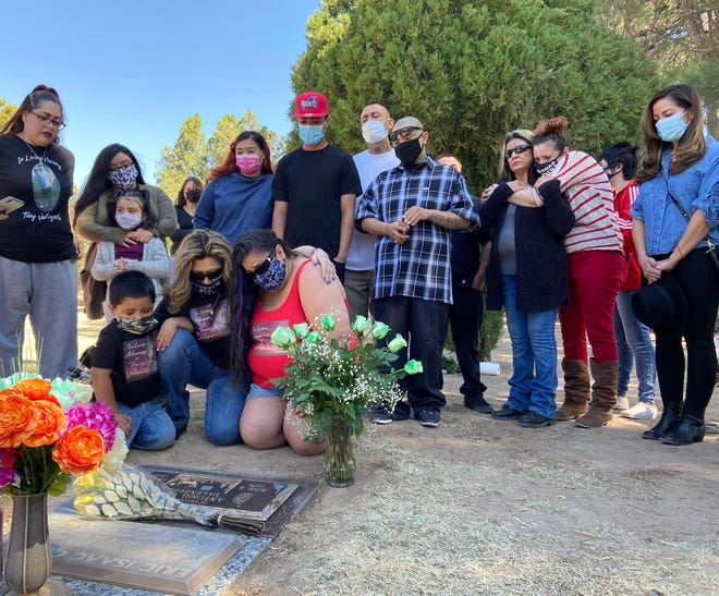 Family and friends of Antonio Valenzuela, who was killed in a struggle with police Feb. 29, 2020, gather at his gravesite Sunday Feb. 28, 2021, for a balloon release ceremony.