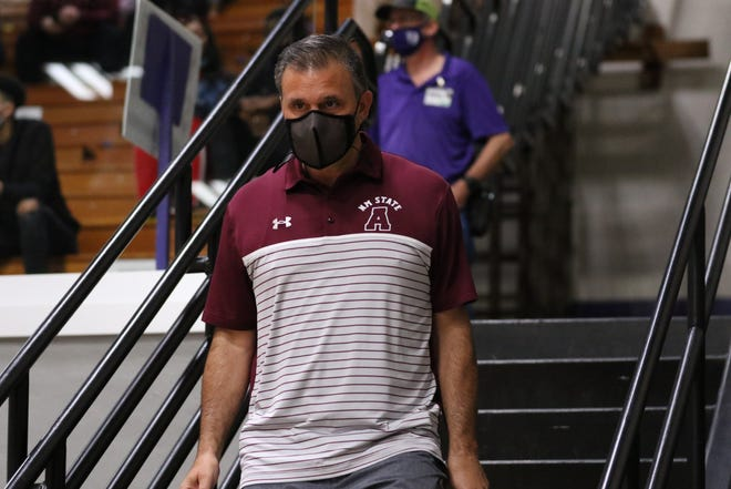 New Mexico State head coach Chris Jans prepares to coach his team during a game against Tarleton State on Feb. 27, 2021, in Stephenville, Texas.