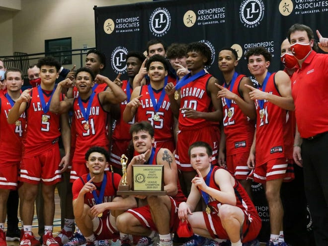 The Lebanon High boys basketball team shows off its gold medals and championship trophy after edging Hempfield 41-40 in the Lancaster-Lebanon League championship game Saturday afternoon at Manheim Township. It was the Cedars' first L-L title since 2004 and came in heartstopping fashion after Hempfield nearly came all the way back from a 24-12 halftime deficit. Isaiah Rodriguez led Lebanon with 15 points, Luke Collins added 14 and Marquis Ferraira added 10 for the Cedars, who clinched the win when Hempfield missed a potential game-tying free throw in the final seconds.