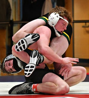 Red Lion's Ryan Fry, front, and Carlisle's Sean Smith wrestle in the 160-pound final during the District 3 Southcentral Region Class 3-A meet. Fry has qualified for Saturday's 3-A West Super Regional in Altoona and is now considered a 2021 state qualifier.