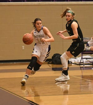 San Saba High School's Courtnee Cash (14) drives along the baseline while Harper's Talli Millican defends during a Region IV-2A quarterfinal girls basketball game Wednesday, Feb. 24, 2021.