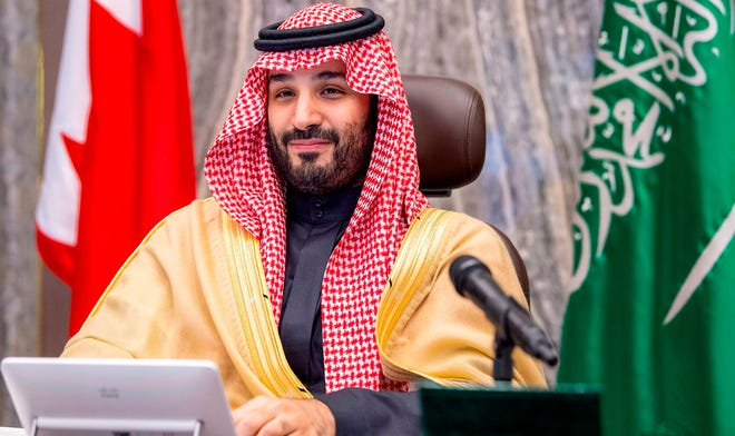 A handout picture provided by the Saudi Royal Palace on Dec. 24, 2020 shows Saudi Crown Prince Mohammed bin Salman attending by videoconference a meeting with Bahrain's Crown Prince of the Saudi-Bahraini Coordinating Council.