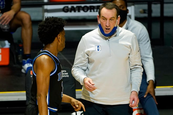 Duke head coach Mike Krzyzewski talks to guard Jeremy Roach (3).