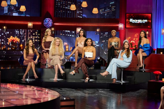 """Serena P., Anna, MJ, Mari, Pieper, Chelsea, Victoria, and Serena C. sit onstage during the """"Women Tell All"""" special."""