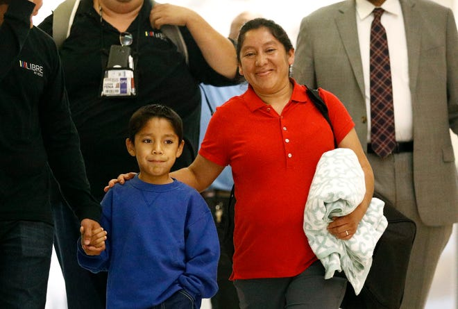 Darwin Micheal Mejia and his mother Beata Mariana de Jesus Mejia-Mejia are reunited on June 22, 2018 in Linthicum, Md., after they were separated at the border and she sued the U.S. government.