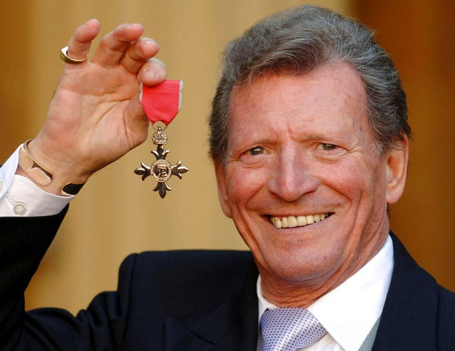 "British actor Johnny Briggs, best known for his role as businessman Mike Baldwin in the long-running TV soap opera ""Coronation Street"" died at age 85. He's pictured here March 7, 2007 after collecting an MBE from Queen Elizabeth II at Buckingham Palace in London."