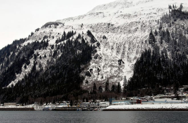 """The Behrends Avenue avalanche path, center, is shown on Mount Juneau in this March 13, 2007, file photo. Alaska's capital city of Juneau elevated its urban avalanche forecast to """"extreme"""" danger on Saturday."""