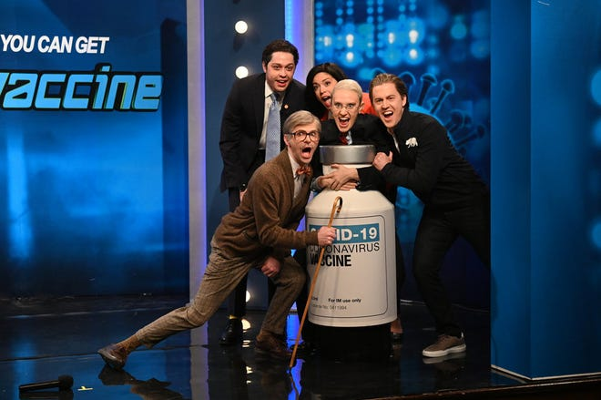 """From left to right, Pete Davison as Gov. Andrew Cuomo, Mikey Day, Cecily Strong as Gov. Gretchen Whitmer, Kate McKinnon as Dr. Anthony Fauci, and Alex Moffat as Gov. Gavin Newsom during """"SNL""""s """"Vaccine Game Show"""" cold open on Feb. 27."""