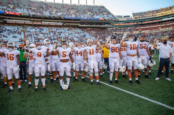 """Texas players sing """"The Eyes of Texas"""" after last season's 26-16 win over Baylor. Newly-hired football coach Steve Sarkisian said players would sing the school song this coming season."""