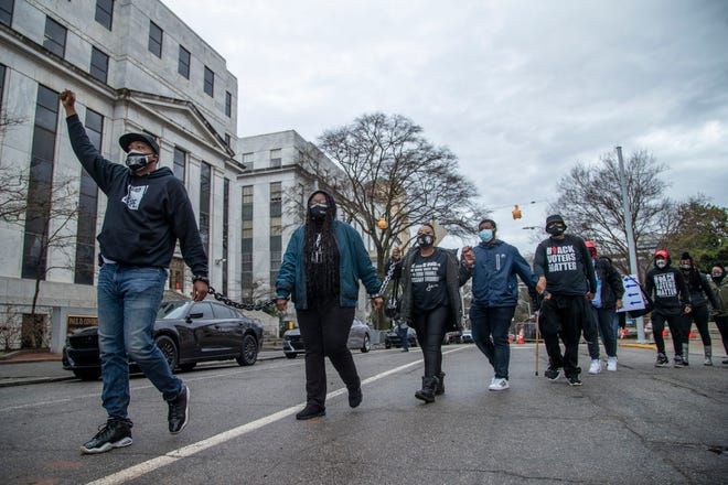 Demonstrators chained together protest proposed voting curbs at the Georgia State Capitol in Atlanta on Monday, March 1, 2021. (Alyssa Pointer/Atlanta Journal-Constitution via AP)