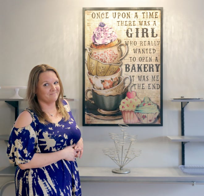 Kimberly Nader, owner of Kneaded Breads & Confections, stands inside her bakery on Sackett Avenue in Cuyahoga Falls.