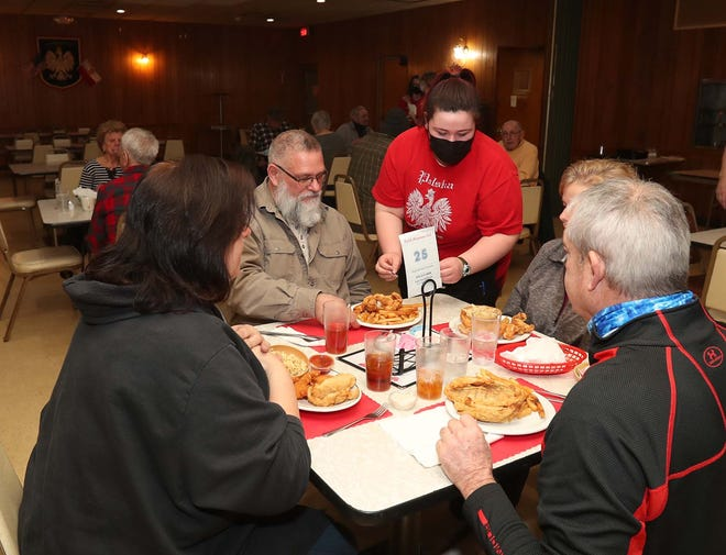 Siobhan Weatherford serves meals at a Feb. 26 fish fry at the Polish American Citizens Club in Akron's North Hill neighborhood. The fish fry is every Friday evening in the club at Glenwood Avenue and Dan Street.