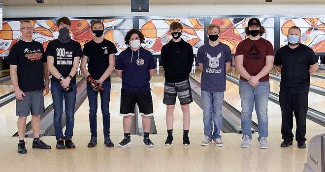 Ashland High boys bowling team members (l-r) head coach Mark Dreibelbis, Avery Brown, Brysen Long, Parker Grissinger, Coen Zehner, Zion Caudill, Aiden Brown and assistant coach Jim Brown pose for a photo at practice Monday at Luray Lanes.