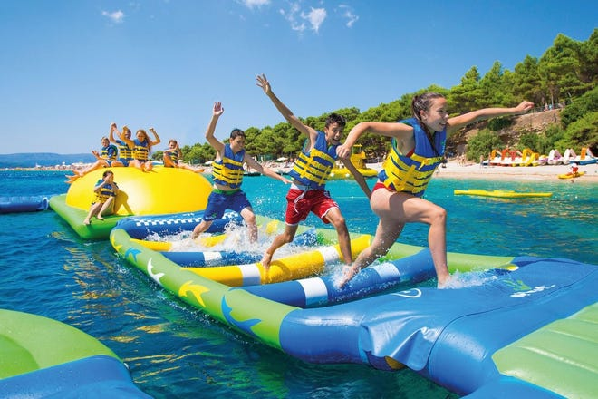 An action obstacle course like this will be installed at the Pleasant Hill beach in time for opening Memorial Day weekend. The WhoaZone inflatable course also will be installed at Atwood Lake Park in Carroll County. Both are facilities of the Muskingum Watershed Conservancy District.