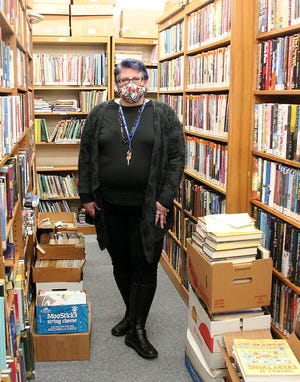 Lissa Gerwig Lance is president of the Friends of the Ashland Public Library and poses in the Friends room Feb. 06, 2021. LIZ A. HOSFELD/FOR TIMES-GAZETTE.COM