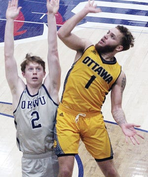 Brandon Bird, left, of Oklahoma Wesleyan University bumps with an Ottawa (Kan.) College player during postseason action last weekend in Bartlesville.