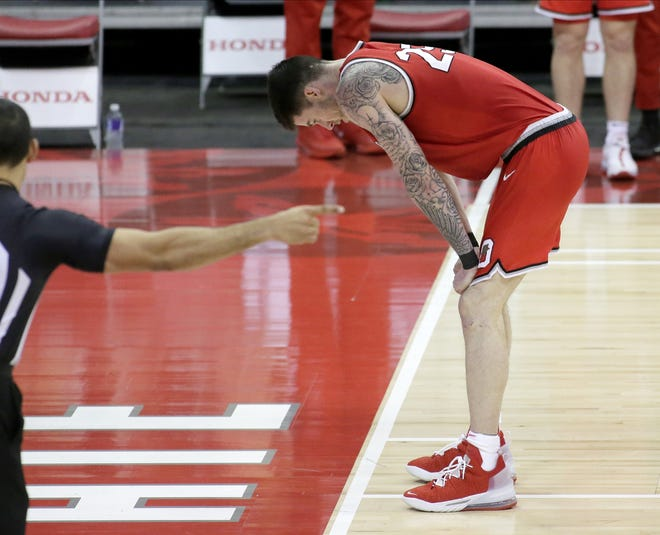 """Ohio State forward Kyle Young rests momentarily after failing to collect a rebound Sunday against Iowa. After the loss, coach Chris Holtmann said """"We clearly didn't have the (normal) bounce, and I've got to figure out why."""""""