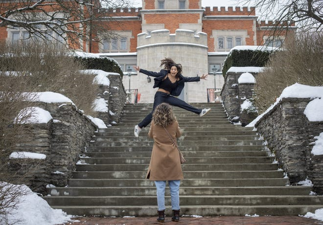 Taegan Meredith, 21, of Cleveland takes photos of her Capital University classmate Aubri Jones, 20, of Middletown outside the Jeffrey Mansion in Bexley on Friday, Feb. 19, 2021. Jones was having a little fun in between serious poses for pictures that she will use in her student government election campaign.