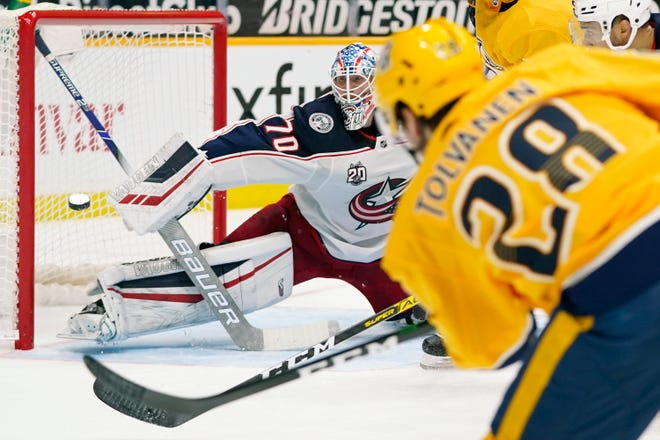 Nashville forward Eeli Tolvanen gives the Predators the lead for good Sunday by slipping a power-play goal past Blue Jackets goaltender Joonas Korpisalo in the second period, helping send Columbus to its fifth straight defeat.