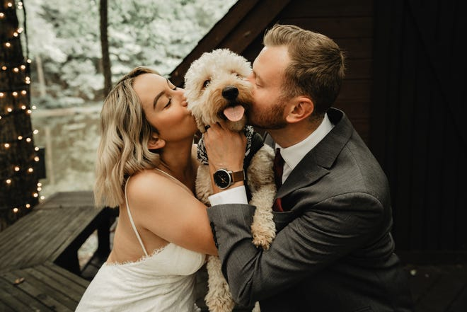 Ameira and Davy Staudt and their dog, Archer, at their post-elopement photo shoot in Lancaster