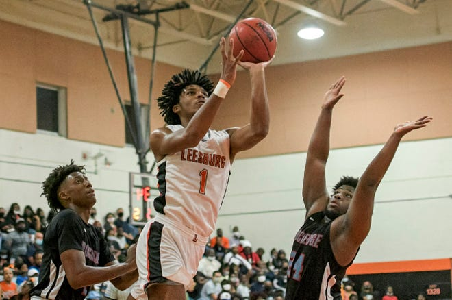 Leesburg's Justice Robinson takes a shot during Friday's  Class 5A-Region 2 championship game against Rockledge at The Hive in Leesburg. [PAUL RYAN / CORRESPONDENT]