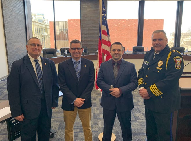 The Cambridge Police Department hosted a recent swearing-in ceremony for Matthew Scurlock, third from the left, the newest officer to join the force. Scurlock is a 14-year veteran of local law enforcement after serving with the Guernsey County Sheriff's Office since August 2006. Scurlock will bea patrolman with the city. Shown with him are, from left, Cambridge Safety Director Rocky Hill, Mayor Tom Orr and Police Chief Mark DeLancey.