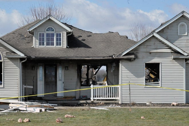 An explosion at the house on North Honeytown Road blasted the front window from its frame and threw it into the front yard. The explosion also lifted the house off the foundation and buckled the roof.