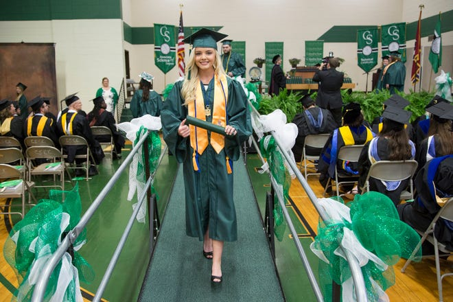 Megan Ski Hollingsworth, 18, makes her way down to the podium after receiving her diploma from Columbia State Community College on May 6, 2017.