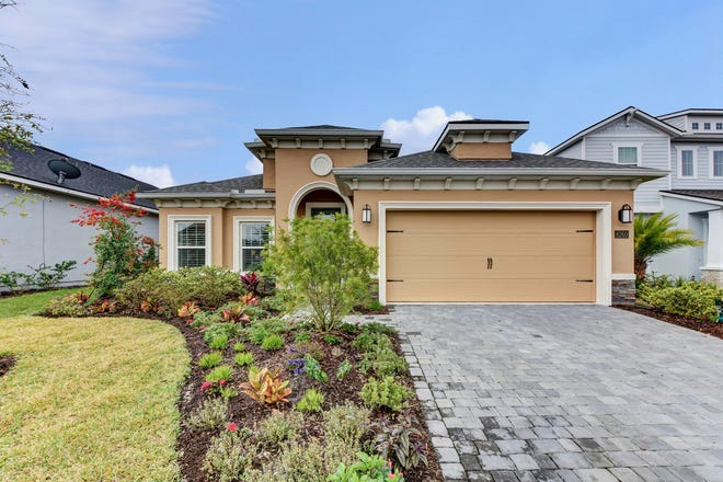 This beautiful lakefront home is located in Port Orange's new gated community of Spruce Meadow at Woodhaven.