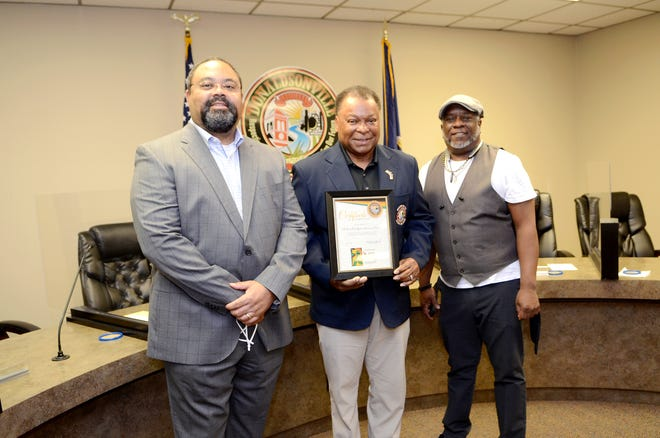 River Road African American Museum Board Chair Todd L. Sterling and acting Executive Director and Co-Founder Darryl Hambrick receive a certificate of appreciation from Donaldsonville Mayor Leroy Sullivan Feb. 25 at City Hall.