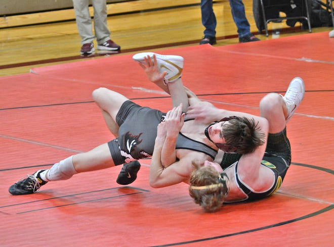 Union City's Brayton Mears turns his Coloma opponent for big near fall points Saturday. Mears went on to win in a key matchup