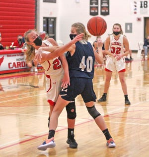Coldwater's Allison Miller threads a pass to an open teammate in the paint Saturday