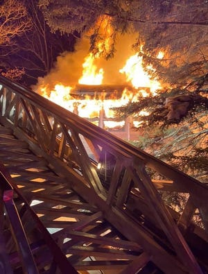 Photos were posted by Hemlock Farms 29 EMT Moore, and Greeley 23-4 on Facebook. In this photo, Hemlock Farms' ladder is in place to help battle the fire that was consuming the sun room  on Washington Drive in Hemlock Farms, February 21. There were no injuries.