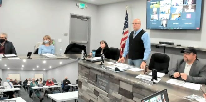 Blooming Grove Township held a special meeting, Feb. 23, 2021, to discuss with other municipal officials, a far and equitable way to pay for shared ambulance services. In this picture from Zoom, seated from left are Lance Spodek, chairman, Emergency Services Commission; Solicitor Stacey Beecher; and supervisors Tammy Gillete, Chairman Nicholas Mazza and Timothy Morey. Inset: part of the attendees at the building; others were on Zoom.