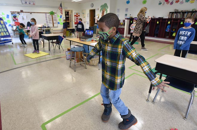 Shane Alexander, 6, a kindergartner at JoAnna Connell Elementary School, dances during an activity with his classmates.