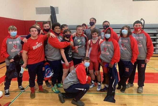 The Hornell wrestling team honors Alex Lockwood, who officially eclipsed the 100-win mark for his career on Saturday afternoon in Letchworth.