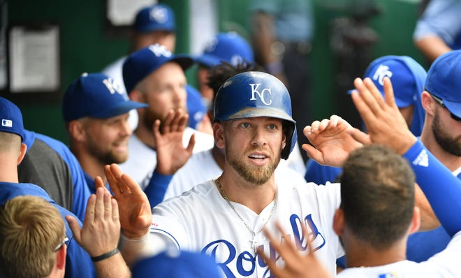 Third baseman Hunter Dozier, center has reportedly agreed to a four-year, $25 million contract extension with the Kansas City Royals.